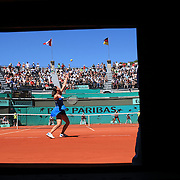 Jelena Jankovic, Serbia, in actiona against Jarmila Groth, Australia,  during the third round match at the French Open Tennis Tournament at Roland Garros, Paris, France on Saturday, May 30, 2009. Photo Tim Clayton.