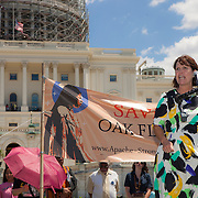 """Representative Betty McCollum (D-MN-4) speaks to members of the San Carlos Apache Tribe and their supporters in front of the United States Capitol to protest the transfer of Apache land to a private Australian-British mining corporation.  In December 2014, a rider to the National Defense Authorization Act handed over Oak Flat to a foreign-owned company looking to mine copper.  The Apache are currently """"occupying"""" Oak Flat, and travelled to D.C. to protest the action.  In response, Rep. Raul Grijalva (D-AZ), proposed the Save Oak Flat Act (H.R. 2811) in June, 2015 to repeal the land exchange.  Rep. McCollum is a co-sponsor of that bill.  John Boal Photography"""