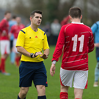 Newmarkets David McCarthy gets a warning from the match Referee