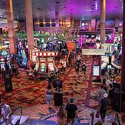 People social distancing gamble in a casino in Las Vegas, Nevada on Sunday, October 18, 2020. (Alex Menendez via AP)