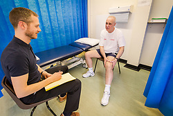 Physiotherapist with patient at health centre gym, London Borough of Haringey, UK