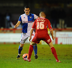 Bristol Rovers' Tom Lockyer looks to go past Crawley Town's Nicky Adams - Photo mandatory by-line: Seb Daly/JMP - Tel: Mobile: 07966 386802 08/01/2014 - SPORT - FOOTBALL - Broadfield Stadium - Crawley - Crawley Town v Bristol Rovers - FA Cup - Replay