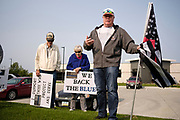 "19 SEPTEMBER 2020 - ALTOONA, IOWA:  TOM WICKERSHAM, right, leads a prayer for the police before a rally in front of the police station in Altoona, a suburb of Des Moines. About 30 people attended an ""Uplifting Our Police"" rally there to show support for not just Altoona police, but law enforcement across the country.      PHOTO BY JACK KURTZ"