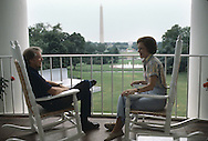 President Jimmy Carter and First Lady Rosalynn Carter relax on the Trumany Balcony.  This photograph was made as part of a behind the scenes look at the Carter White House for TIME magazine. ..Photograph by Dennis Brack bb30