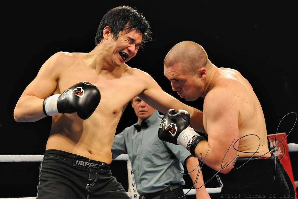 April 3, 2010 - Rumble at the Rock VII - Richmond, BC, Canada - Ty McDougall (Kamloops, BC) v. Victor Wang (Vancouver, BC) - Light Heavyweight Boxing - McDougall (0-1-1) and Wang (Professional Debut) battled for four rounds with McDougall emerging victorious by TKO in the third round. The match was a West Coast Promotions feature held at the River Rock Casino in Richmond, BC, Canada.