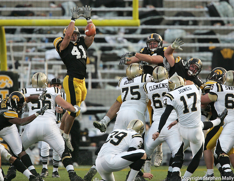 17 NOVEMBER 2007: Iowa linebacker Bryon Gattas (41) blocks a Western Michigan kicker Mike Jones (17) field goal attempt on the last play of the first half of Western Michigan's 28-19 win over Iowa at Kinnick Stadium in Iowa City, Iowa on November 17, 2007.
