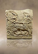 Photo of Hittite relief sculpted orthostat stone panel of Long Wall Basalt, Karkamıs, (Kargamıs), Carchemish (Karkemish), 900 - 700 BC. Anatolian Civilizations Museum, Ankara, Turkey.<br /> <br /> Chariot. One of the two figures in the chariot holds the horse's headstall while the other throws arrows. There is a naked enemy with an arrow in his hip lying face down under the horse's feet. It is thought that this figure is depicted smaller than the other figures since it is an enemy soldier. The tower part of the orthostat is decorated with braiding motifs.<br /> <br /> On a brown art background. .<br />  <br /> If you prefer to buy from our ALAMY STOCK LIBRARY page at https://www.alamy.com/portfolio/paul-williams-funkystock/hittite-art-antiquities.html  - Type  Karkamıs in LOWER SEARCH WITHIN GALLERY box. Refine search by adding background colour, place, museum etc.<br /> <br /> Visit our HITTITE PHOTO COLLECTIONS for more photos to download or buy as wall art prints https://funkystock.photoshelter.com/gallery-collection/The-Hittites-Art-Artefacts-Antiquities-Historic-Sites-Pictures-Images-of/C0000NUBSMhSc3Oo