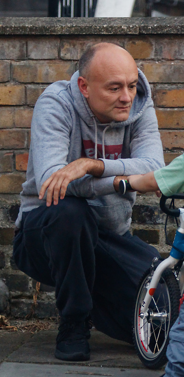 PICTURE EXCLUSIVE - SPECIAL FEES APPLY - CALL BEFORE USE<br /> London, United Kingdom - 8 September 2019<br /> Dominic Cummings looks startled to be spotted arriving back at his north London home on Sunday after a day out with his wife, Mary Wakefield, his son and some friends. Despite clutching a new child's bicycle and fussing over his young son, at times he seemed lost in his thoughts as he tried to focus on his family rather than the dramatic and explosive week in Westminster politics. As Boris Johnson's special political advisor, the former campaign director of Vote Leave has this week found himself at the centre of controversy and harsh criticism from MPs over the handling of the sacking of twenty one rebel Conservative MPs.<br /> EXCLUSIVE PICTURES - MANDATORY BYLINE: EQUINOXFEATURES.COM - A charge is made for each use of each picture in each format on each platform in each territory.<br /> (photo by: EQUINOXFEATURES.COM)<br /> Picture Data:<br /> Photographer: Equinox Features<br /> Copyright: ©2019 Equinox Licensing Ltd. +443700 780000<br /> Contact: Equinox Features<br /> Date Taken: 20190908<br /> Time Taken: 18473306<br /> www.newspics.com