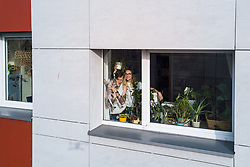"""**ALL PHOTOS WERE TAKEN WITH CONSENT AND WITH PERMISSION TO SHARE IMAGES**<br /> <br /> A photographer has used his drone to capture images of people quarantined in their homes during the coronavirus pandemic.<br /> <br /> The heartwarming photos show how Lithuanian families are spending their time in lockdown, away from the outside world.<br /> <br /> Photographer Adas Vasiliauskas explained how due the cancellation of his usual advertising photography jobs he decided to make the most of social distancing and show how people are brought together in a time of isolation.<br /> <br /> Adas explains: """"At first I thought of offering to shoot people with a telephoto lens, but then I remembered I use a drone in my wedding photography and the drone is a totally zero-human-contact way to capture things.'<br /> <br /> """"I shot a few of my friends, the photos gained a lot of likes, and the project took off.""""<br /> <br /> The images show the various ways people are keeping themselves entertained during the pandemic, ranging from playing dress up with their children to sunbathing on rooftops.<br /> <br /> """"I started this project to give people a chance to brighten their day in this negative corona information environment.' Adas continues.<br /> <br /> """"I believe that these funny photos remind everyone that sitting quarantined at home can be fun too. And, of course, to remind everybody that you need to keep your social distance during these times.""""<br /> <br /> Where: Vilnius, Lithuania<br /> When: 24 Mar 2020<br /> Credit: Adas Vasiliauskas/Cover Images<br /> <br /> **EDITORIAL USE ONLY. MATERIALS ONLY TO BE USED IN CONJUNCTION WITH EDITORIAL STORY. THE USE OF THESE MATERIALS FOR ADVERTISING, MARKETING OR ANY OTHER COMMERCIAL PURPOSE IS STRICTLY PROHIBITED. MATERIAL COPYRIGHT REMAINS WITH ADAS VASILIAUSKAS.**"""