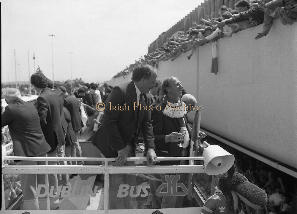 Irish Soccer Team Welcomed Home.   (R81)..1988..19.06.1988..06.19.1988..19th June 1988..After their great success in Germany in Euro 88, the Irish soccer team had a triumphant homecoming. An Taoiseach, Charles Haughey TD and his government were to the forefront of the welcome. Thousands of fans thronged the airport and all the approach roads in the hope of seeing the team. The full squad is as follows..1.GK.Packie Bonner. Celtic.2.DF.Chris Morris. Celtic.3.DF.Chris Hughton  Tottenham Hotspur.4.DF.Mick McCarthy. Celtic.5.DF.Kevin Moran. Manchester United.6.MF.Ronnie Whelan. Liverpool.7.MF.Paul McGrath. Manchester United.8.MF.Ray Houghton. Liverpool.9.FW.John Aldridge. Liverpool.10.FW.Frank Stapleton Derby County.11.MF.Tony Galvin. Sheffield Wednesday.12.FW.Tony Cascarino. Millwall.13.MF.Liam O'Brien. Manchester United.14.FW.David Kelly. Walsall.15.MF.Kevin Sheedy. Everton.16.GK.Gerry Peyton. Bournemouth.17.FW.John Byrne. Le Havre.18.FW.John Sheridan. Leeds United.19.DF.John Anderson. Newcastle United.20.FW.Niall Quinn. Arsenal..Image shows the management team of Maurice Setters and Jack Charlton together on the team bus.