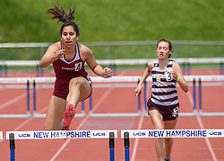 Hanover freshman Olivia Trummel clears the final hurdle in the girls 300 meter hurdles, flanked by Lebanon's Zoe China at the NHIAA Division II track and field championship at UNH on Saturday, May 25, 2019.  Trummel placed second in the event.  (Alan MacRae/Valley News)