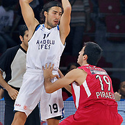 Anadolu Efes's Sasha VUJACIC (L) during their Two Nations Cup basketball match Anadolu Efes between Olympiacos at Abdi Ipekci Arena in Istanbul Turkey on Sunday 02 October 2011. Photo by TURKPIX