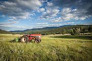 International Tractor and hay rake in hay meadow at Corral Creek Ranch in Evergreen, Colorado.