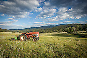 International Tractor and hay rake in hay meadow at Corral Creek Ranch in Evergreen, Colorado.