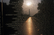At dawn, a week after the September 11th attacks in New York and in Washington DC, we see the haunted figures of war veterans looking up at the names of dead comrades of the Vietnam Veterans Memorial in Constitution Gardens, Washington DC where 58,195 names of casualties are recorded on its polished wall. In the foreground are some of those mens' identities whose average age was 19 in the sixties and seventies. A hazy sun rises over the point of the Washington Memorial at a time when the nation was mourning those killed in the New York and Washington attacks, when the military was about to mobilise once again with many American lives lost. The Vietnam war however, remains a low-point in the nation's history and the old men who survived return to trace their buddies which helps them deal with the traumatic loss of their friends and their own youth. .