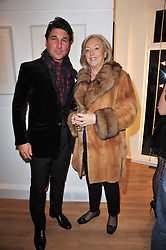 GIORGIA VERONI and his mother in law PAULA BECKWITH at a party to launch Alistair Taylor-Young's new book 'The Phone Book' held at The Little Black Gallery, 13A Park Walk, London SW10 on 18th January 2011.