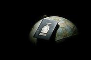 Photo Randy Vanderveen.A Canadian passport sits atop a globe.