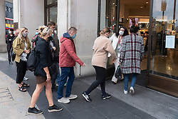 © Licensed to London News Pictures. 02/09/2021. London, UK. Customers enter the H&M Regent Street store to buy items from TOGA ARCHIVES X H&M clothes collection. Designed by Yasuko Furuta, founder and designer of TOGA in collaboration with H&M, the collection. Includes women's and mens clothes. Photo credit: Ray Tang/LNP