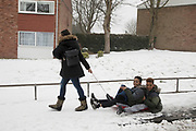 People having fun in freezing weather, dubbed The Beast from the East due to the sub zero cold temperature winds coming in from Siberia, descends on Kings Heath High Street on 3rd March 2018 in Birmingham, United Kingdom.