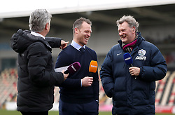 Television pundit's Des Kelly (left) and Glenn Hoddle interview Newport manager Michael Flynn (centre) during the Emirates FA Cup, fourth round match at Rodney Parade, Newport.