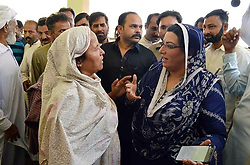 May 13, 2019 - Pakistan - SIALKOT, PAKISTAN, MAY 12: Special Assistant to Prime Minister on Information and .Broadcasting, Dr. Firdous Ashiq Awan is listening the problems of people during open court .public meeting held at Koobey Chak in Sialkot on Sunday, May 12, 2019. (Credit Image: © PPI via ZUMA Wire)