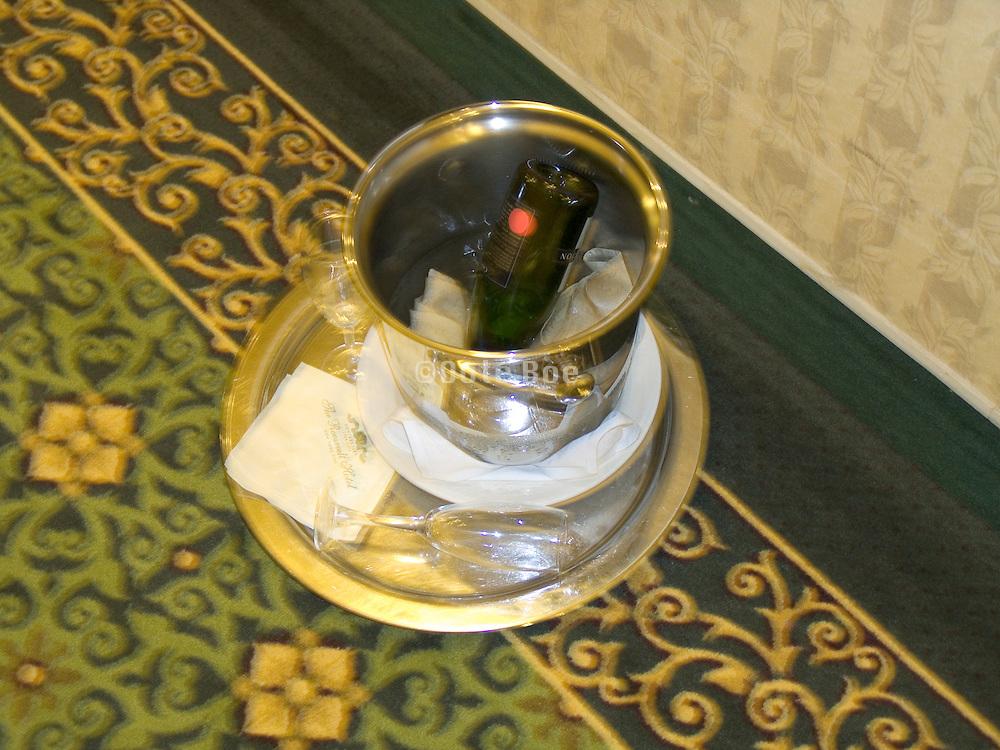 empty champagne bottle placed upside down in ice bucket