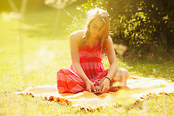 Teenage Girl Listening to Music in Garden