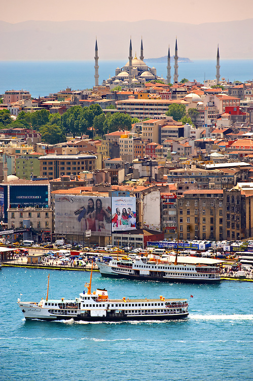 The Sultan Ahmed Mosque (Sultanahmet Camii or Blue Mosque 1609 to 1616 ) on Sarayburnu or Seraglio Point with a ferry and the banks of the Golden Horn in the foreground, Istanbul Turkey. .<br /> <br /> If you prefer to buy from our ALAMY PHOTO LIBRARY  Collection visit : https://www.alamy.com/portfolio/paul-williams-funkystock/istanbul.html<br /> <br /> Visit our TURKEY PHOTO COLLECTIONS for more photos to download or buy as wall art prints https://funkystock.photoshelter.com/gallery-collection/3f-Pictures-of-Turkey-Turkey-Photos-Images-Fotos/C0000U.hJWkZxAbg