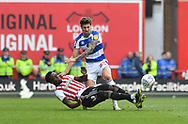 Brentford defender Moses Odubajo (2) and Rangers Pawel Wszolek*** during the EFL Sky Bet Championship match between Brentford and Queens Park Rangers at Griffin Park, London, England on 2 March 2019.