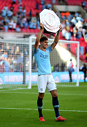 Manchester City's John Stones celebrates with the Community Shield at full time