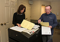 Sandra McGonagle and Larry Routhier check through the test ballots in the voting machines in preparation for the upcoming Gilford Town Election on March 10th.  (Karen Bobotas/for the Laconia Daily Sun)