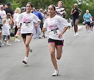 Middletown, New York - Ashley,  right, and Amy Gonzalez of Middletown race to the finish line in the 15th annual Ruthie Dino Marshall 5K Run and Fun Walk hosted by the Middletown YMCA on Sunday, June 5, 2011. ©Tom Bushey / The Image Works