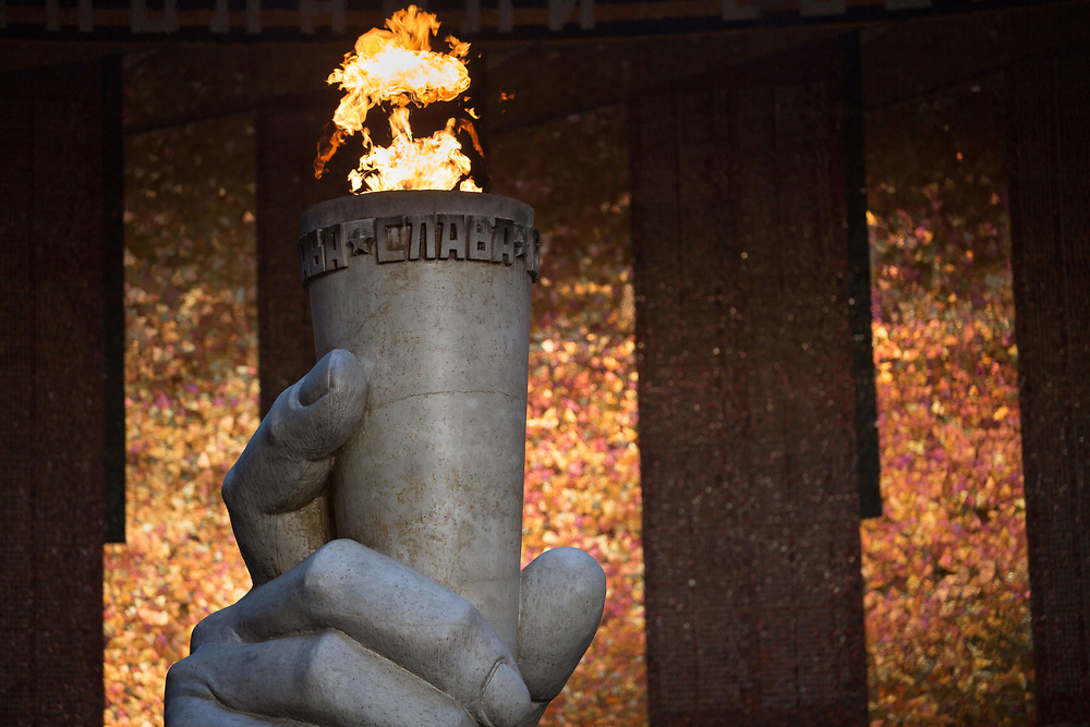 CAPTION: The 'eternal flame of life' burns constantly in the Hall of War Glory, surrounded by the names of ten of thousands who died during the Battle of Stalingrad, a turning point in the Second World War. LOCATION: Hall of War Glory, Mamayev Kurgan, Volgograd, Russia. INDIVIDUAL(S) PHOTOGRAPHED: N/A.