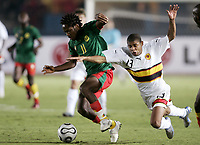 Fotball<br /> Foto: Dppi/Digitalsport<br /> NORWAY ONLY<br /> <br /> FOOTBALL - AFRICAN CUP OF NATIONS 2006 - FIRST ROUND - GROUP B - 060121 - CAMEROON v ANGOLA<br /> <br /> JEAN MAKOUN (CAM) / EDSON NOBRE (ANG)<br /> <br /> KAMERUN v ANGOLA