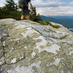 A hiker on the summit of Mount Cube in Orford, New Hampshire.  Appalachian Trail.