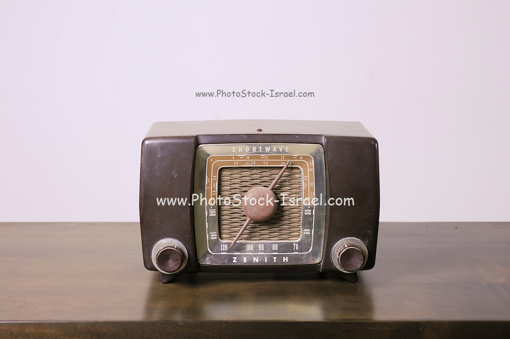 Cutout of a retro Zenith transistor radio receiver on white background