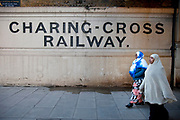 Muslim women in Southwark, London, old signs for Blackfriars Station and The Charing CRoss Railway company can be found.