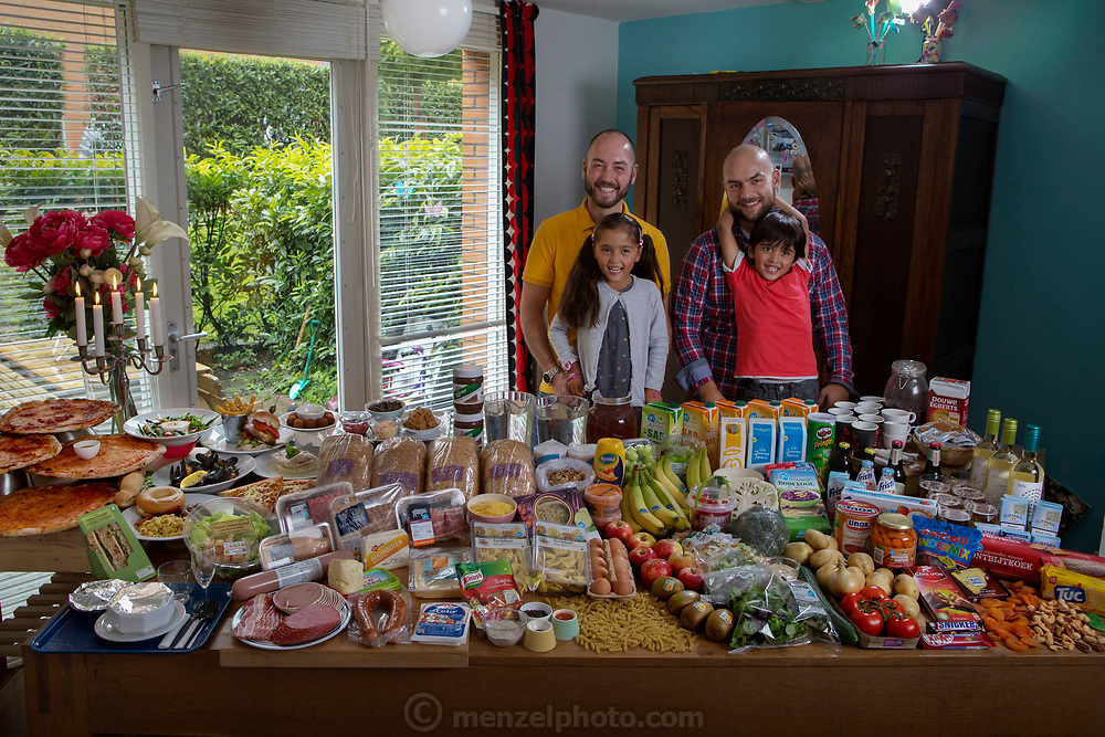 The Hague, Netherlands. Family portrait of the Voeten-Case family with one week's worth of food in September. The Hungry Planet project.