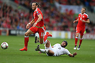 Gareth Bale of Wales is tackled by Murtaz Daushvili of Georgia. Wales v Georgia , FIFA World Cup qualifier, European group D match at the Cardiff city Stadium in Cardiff on Sunday 9th October 2016. pic by Andrew Orchard, Andrew Orchard sports photography