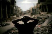 A boy looks at the destruction due to Jan.12 earthquake in downtown Port-au-Prince, Haiti, Jan. 25,  2010. (AP Photo/Rodrigo Abd)