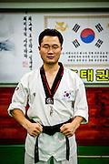 Portrait of a teacher for Taekwondo at a school for children in Daegu. Taekwondo is a Korean martial art and the national sport of South Korea.