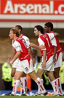 07/05/2003 Arsenal v Southampton, FA Barclaycard Premiership, Highbury<br />Robert Pires celebrates his goal with Ray Parlour, skipper for the evening, and Kanu<br />Photo. Javier Garcia, Digitalsport