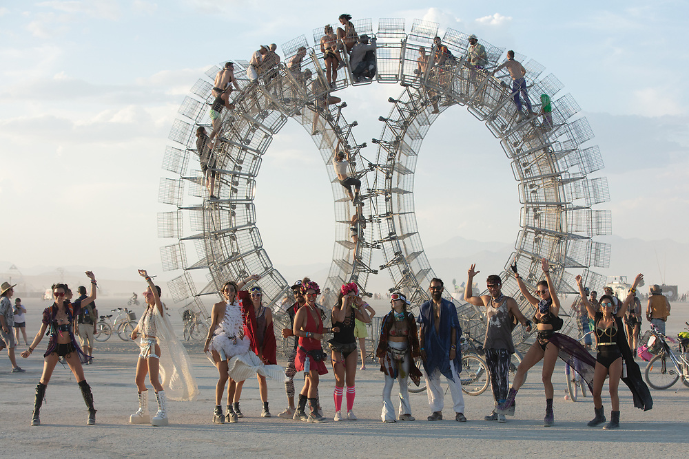 These folks asked me to take their picture. One of them handed me a disposable camera! I hadn't seen one in years. I asked them to take one with my camera. They weren't as keen for my image as you can see fromt he half heated smiles here... Wonder if the disposable camera image turned out. My Burning Man 2018 Photos:<br /> https://Duncan.co/Burning-Man-2018<br /> <br /> My Burning Man 2017 Photos:<br /> https://Duncan.co/Burning-Man-2017<br /> <br /> My Burning Man 2016 Photos:<br /> https://Duncan.co/Burning-Man-2016<br /> <br /> My Burning Man 2015 Photos:<br /> https://Duncan.co/Burning-Man-2015<br /> <br /> My Burning Man 2014 Photos:<br /> https://Duncan.co/Burning-Man-2014<br /> <br /> My Burning Man 2013 Photos:<br /> https://Duncan.co/Burning-Man-2013<br /> <br /> My Burning Man 2012 Photos:<br /> https://Duncan.co/Burning-Man-2012