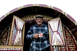 © Licensed to London News Pictures. <br /> 05/06/2014. <br /> <br /> Appleby, Cumbria, England<br /> <br /> Trevor Jones from the Wirral enjoys a morning cuppa as gypsies and travellers gather during the annual horse fair on 5 June, 2014 in Appleby, Cumbria. The event remains one of the largest and oldest events in Europe and gives the opportunity for travelling communities to meet friends, celebrate their music, folklore and to buy and sell horses.<br /> <br /> The event has existed under the protection of a charter granted by King James II in 1685 and it remains the most important event in the gypsy and traveller calendar.<br /> <br /> Photo credit : Ian Forsyth/LNP