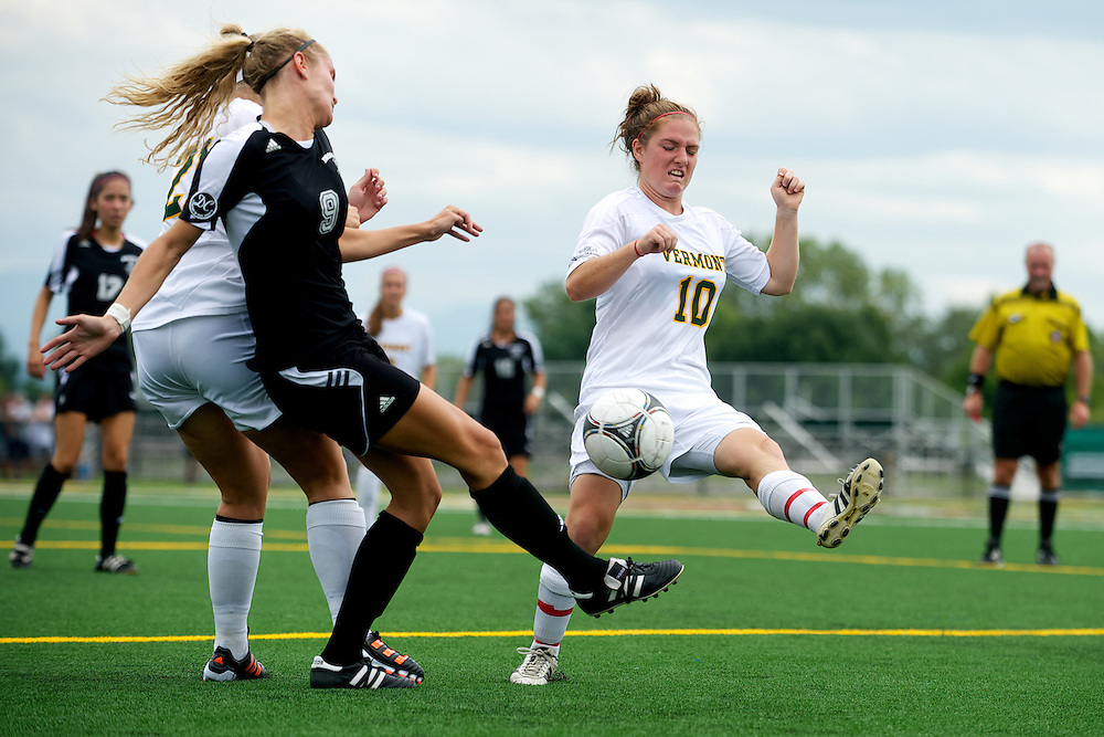 Vermont midfielder Kerry Glynn (10) battle for the ball during the women's soccer game between the Brown Bears and the Vermont Catamounts at Virtue Field on Saturday afternoon September 8, 2012 in Burlington, Vermont.