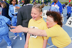 Coach and young disabled girl taking part in Mini games sports event held at Stoke Mandeville Stadium,