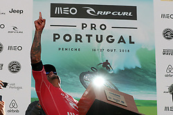 October 20, 2018 - Peniche, Portugal - Italo Ferreira of Brazil celebrates the victory with the trophy after winning the World Surf League MEO Rip Curl Pro Portugal, the 10th event of the WSL Men's Championship Tour, at the Supertubos beach in Peniche, Portugal, on October 20, 2018. (Credit Image: © Pedro Fiuza/ZUMA Wire)