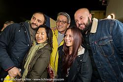 Shige Suganuma with guests at the Monday night afterparty at Mooneyes Area One after the Mooneyes Yokohama Hot Rod & Custom Show. Yokohama, Japan. December 5, 2016.  Photography ©2016 Michael Lichter.