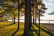 Lake Mitchell at sunset, lampposts at Lakeside Charlies restaurant, Cadillac, Michigan, USA.