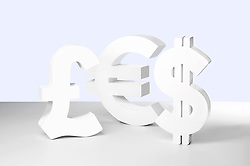 Dollar, Euro and Pound signs on white background (Credit Image: © Image Source/Howard Bartrop/Image Source/ZUMAPRESS.com)
